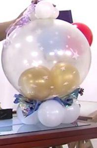 como hacer una piñata de globos 11