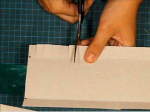 como hacer piñatas con tiras de carton 7